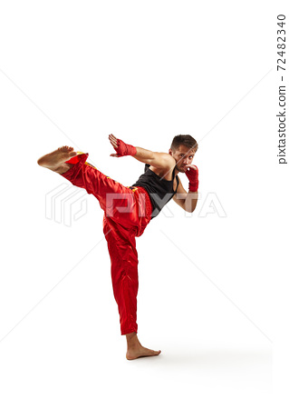 sporty man in red sports bandages fighting 72482340