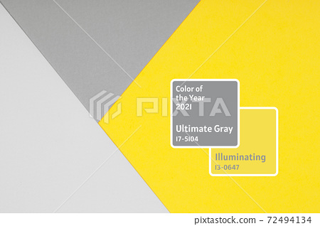 Paper background in two trendy colors of year 2021 - yellow and gray 72494134