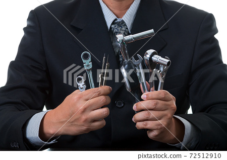 Chief mechanical engineer holding many tools and measurement equipment in his hands 72512910