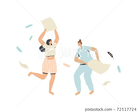 Couple of Young Women in Pajamas Having Pillow Fight at Home with Feathers Flying around. Female Characters Friendship 72517724