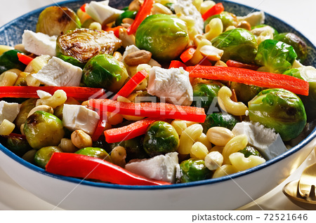 macaroni salad with broccoli sprouts, top view 72521646