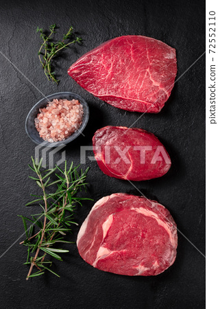 Meat cuts, top shot with salt and rosemary 72552110