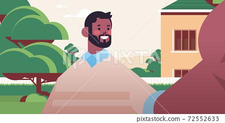 happy african american man taking selfie on smartphone camera guy making self photo outdoor 72552633