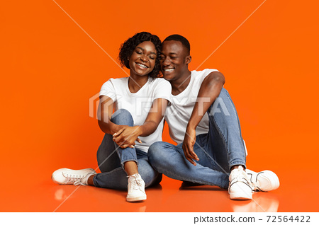 Loving black man and woman having fun, studio shot 72564422