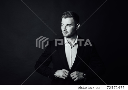 Handsome male businessman with suit posing in a photo studio. Half-length portrait 72571475