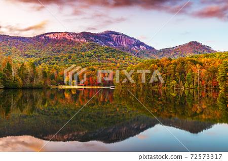 Pinnacle Mountain, Pickens, SC lake view in autumn at dusk. 72573317