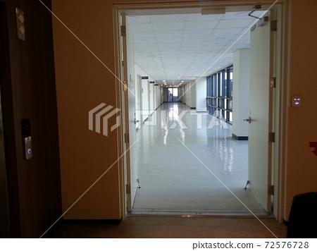 Corridor road beyond the door 72576728