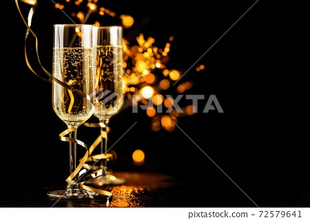 champagne glasses with sparkles 72579641