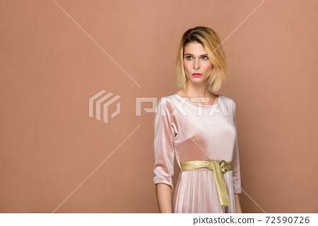 Elegant slender blond woman in chenille suit 72590726