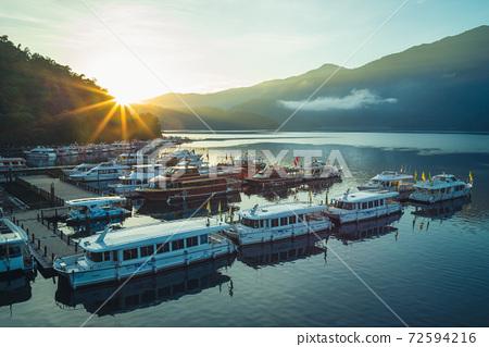 sunrise at sun moon lake in nantou, taiwan 72594216