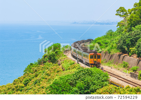 Train runs on South link line of taiwan railway in pingtung county 72594229