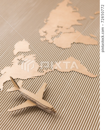 Airplane and world map made of cardboard 72650772