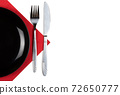 Plate, knfie and fork on a napkin isolated on white background 72650777
