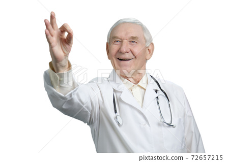 Portrait of old surgeon with ok gesture. 72657215