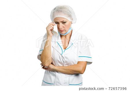 Upset female doctor, white background. 72657396