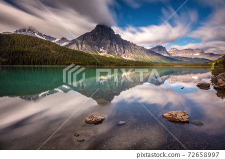 Mountain landscape and reflection 72658997