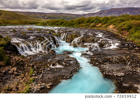 The blue waterfall in Iceland 72659912