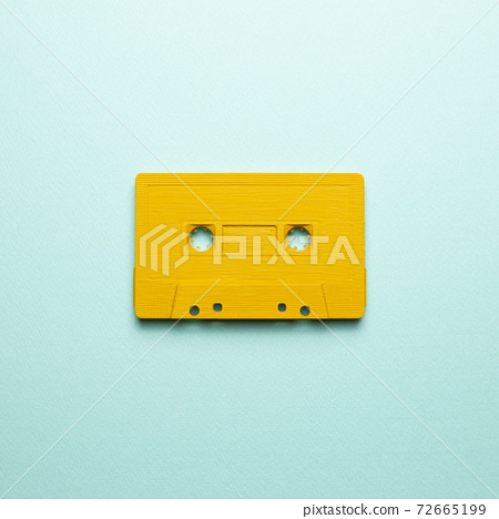 Yellow audio cassette tape on blue background. top view, copy space 72665199