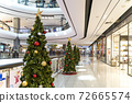 Christmas tree decoration in shopping mall, Shopping arcade soft focus with christmas tree, Department store scene. 72665574