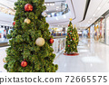 Christmas tree decoration in shopping mall, Shopping arcade soft focus with christmas tree, Department store scene. 72665575