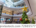 Christmas tree decoration in shopping mall, Shopping arcade soft focus with christmas tree, Department store scene. 72665577