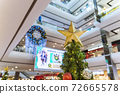 Christmas tree decoration in shopping mall, Shopping arcade soft focus with christmas tree, Department store scene. 72665578