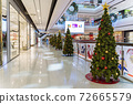 Christmas tree decoration in shopping mall, Shopping arcade soft focus with christmas tree, Department store scene. 72665579
