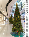 Christmas tree decoration in shopping mall, Shopping arcade soft focus with christmas tree, Department store scene. 72665580