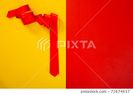 red necktie on color background 72674637