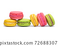 Yellow, pink and green macaron cookies isolated on white background 72688307