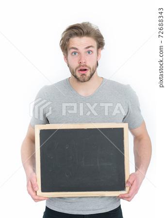 guy or surprised man holding blackboard isolated on white background 72688343
