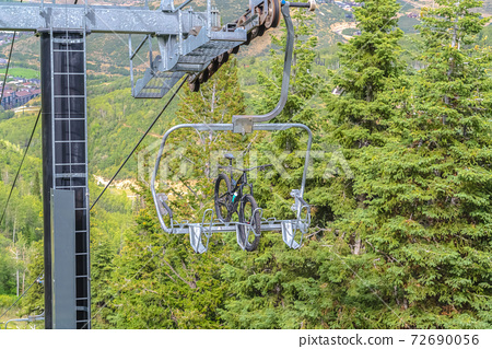 Mountain bike on a lift against trees in Park City ski resort during off season 72690056