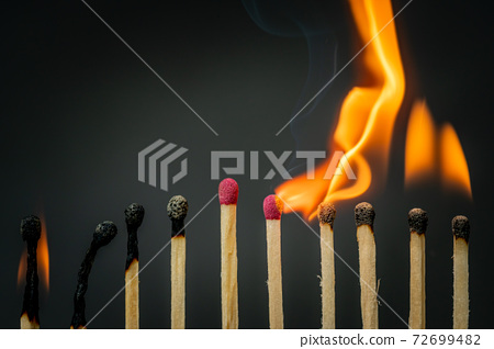 Group of wooden matches with fire 72699482