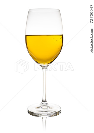 Wineglass with white wine 72700047