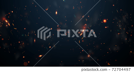 Sparks fly up Glowing particles on a black background and with flames 72704497