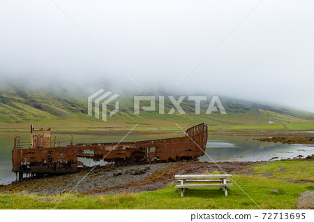 Shipwreck from Mjoifjordur fiord, east Iceland. Icelandic panorama 72713695