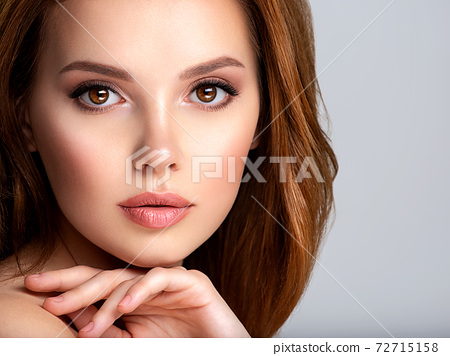 Portrait of beautiful young woman with bright brown makeup. Beautiful brunette with  brown lipstick on her lips. 72715158