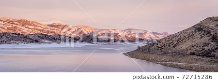 winter panorama of mountain lake at foothills of Rocky Mountains 72715286