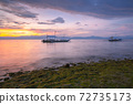 Deamatic sunset over the beach, Philippines 72735173