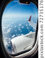 Window view from inside the aircraft during the flight 72735176