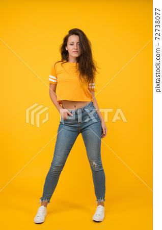 Sexy girl yellow background. Sexi girl. Sensual girl in casual style. 72738077