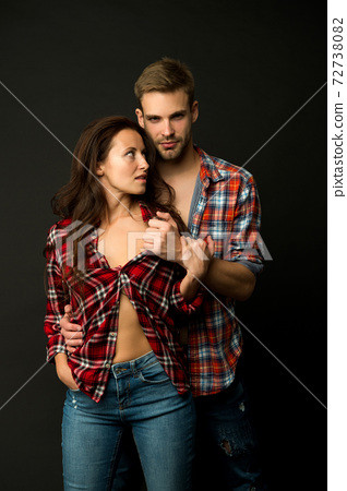 Couple in love. Sexy couple taking off shirts. Passion fashion. macho man undress woman. 72738082