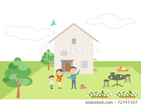 Family posing in front of a new house 72747107