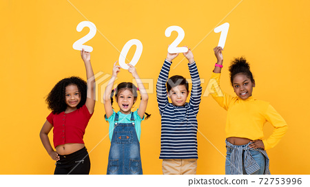 Smiling mixed race children holding 2021 numbers isolated for new year  concepts 72753996