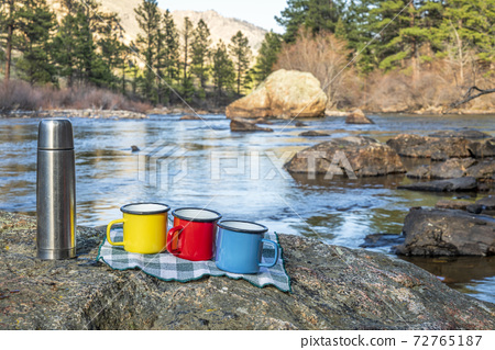 tea break on a shore of mountain river 72765187