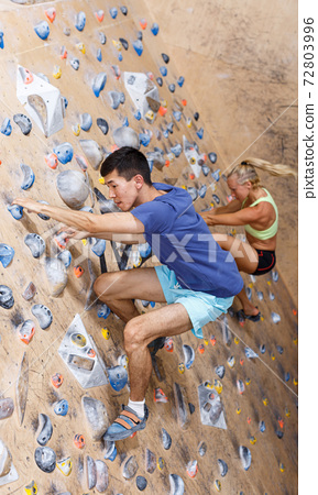 Couple of climbers on joint workout 72803996