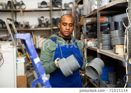 Latin american workman choosing supplies in shop of building materials 72815134