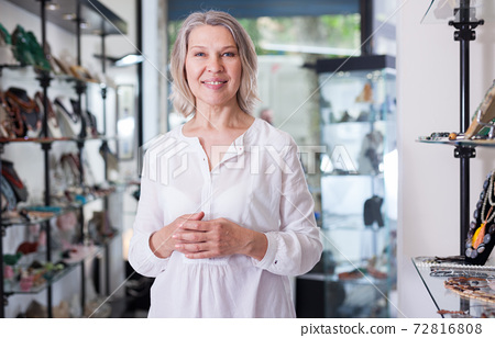 Portrait of a jewelry store woman seller 72816808