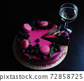 Delicious cake with fresh strawberries, raspberries, blueberry, currants. cut piece of cake and blade on wooden background. 72858725