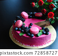 Delicious cake with fresh strawberries, raspberries, blueberry, currants. cut piece of cake and blade on wooden background. 72858727